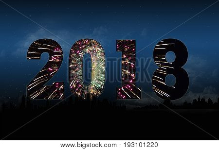 silhouette of city skyline and fireworks for new year 2018