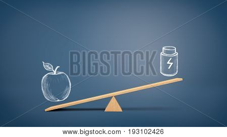 A wooden seesaw with a drawing of an apple overweighting a drawing of a plastic container with a lightning bolt sign. Healthy eating. Natural food. Energy drinks and supplements.