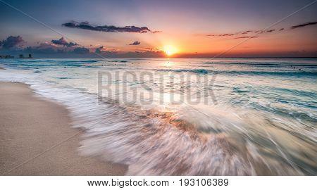 Beautiful sunrise over the beach in Cancun