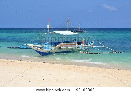 Puka beach, Boracay island, The Philippines - March 2016. The local  philippines boat on the Puka beach.