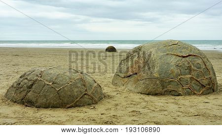 Moeraki Boulders - large and spherical boulders lying along a stretch of Koekohe Beach on the Otago coast of New Zealand