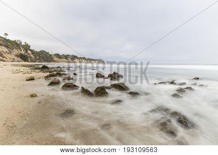 Dume Cove tidal pool rocks with motion blur in Malibu, California.