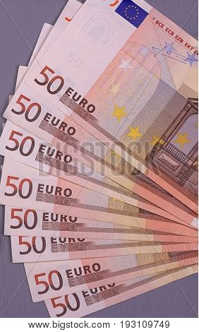 Fifty Euro Banknotes On White Gray Background.