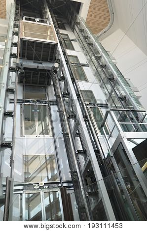 See through elevators machinery inside a mall