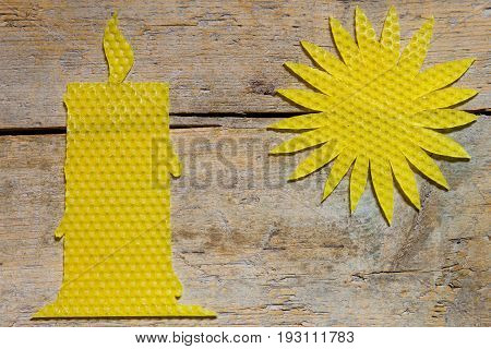 Beeswax, Candle And Sun On Wooden Table