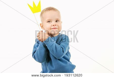Happy Little Boy Playing While Trying On A Paper Crown, Laughing Making Face On White Background
