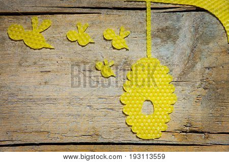 Beeswax, Beehive And Bees On Wooden Table