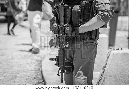 JERUSALEM, ISRAEL. June 20, 2017. Israel Border Police officer outside near the terror attack site at the Damascus gate. Israeli-Palestinian conflict, security measures black and white stock image.