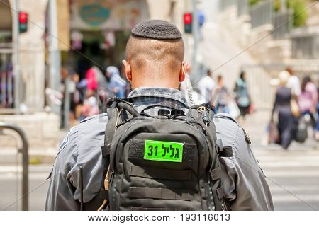 JERUSALEM, ISRAEL. June 20, 2017. Israel Border Police officer looking at the street pedestrian crossing near the terror attack site at the Damascus gate. Israeli-Palestinian conflict stock image.