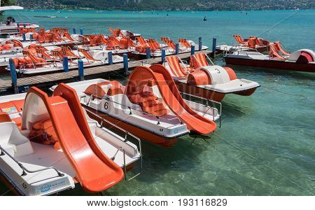 ANNECY FRANCE - JUNE 17 2017: Pedal boats or paddle boats with water slides at Lake Annecy at Haute-Savoie department. France