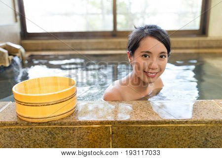 Woman taking bath in the japanese onsen