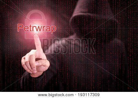 Male hacker pointing Petrwrap or Petya ransomware and red padlock symbol with digital binary code background. cyber attack and internet security concepts