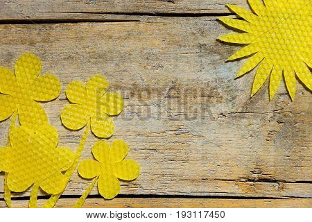 Beeswax, Flowers And The Sun On Wooden Table