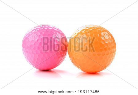pink and orange Miniature Golf Ball On White Background