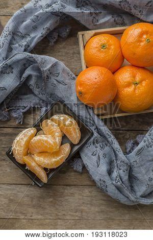 Ripe mandarine citrus . tangerine mandarine orange on wooden background. Mandarins in plate