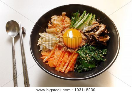 Bibimbap,traditional korean food, famous korean food,korean mixed rice with meat and vegetables and raw  egg yolk