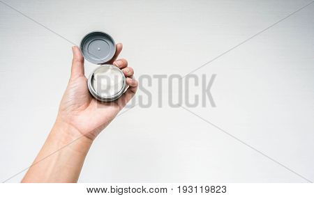 isolated people hand hold wax for hair style