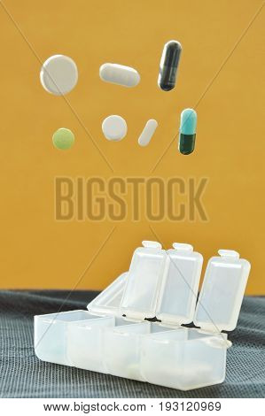 pill and capsule dropping to plastic box