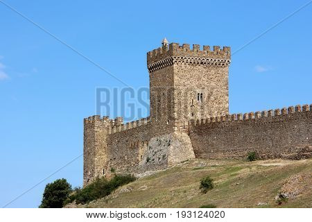 Tower with battlements in the Genoese fortress the Consular castle. The medieval fortress in Sudak in the Crimea.
