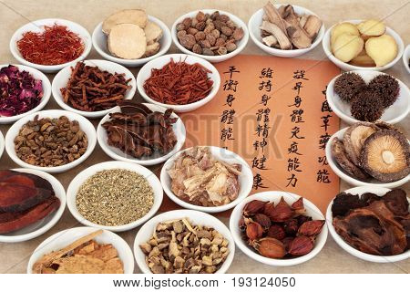 Traditional chinese herbal medicine selection in porcelain bowls with calligraphy script. Translation describes the medicinal functions to maintain body and spirit health and balance energy.