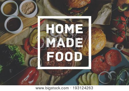 Homemade Cooking Food Concept. Inscription on Ingredients for cooking burgers Background