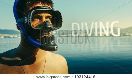 Diving, Inscription on the background of a portrait of a diver with a mask and snorkel. The concept of freediving, tourism and travel