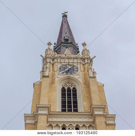 NOVI SAD, SERBIA - APRIL 17 Top of Catholic cathedral in Serbian town, Novi Sad. Photographed the in Novi Sad, Serbia on April 17, 2016