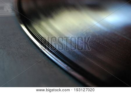 Macro shot of a vinyl record atop it's sleeve.