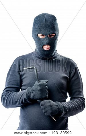 Criminal With A Crowbar In Hands In A Black Balaclava Posing Against A White Background