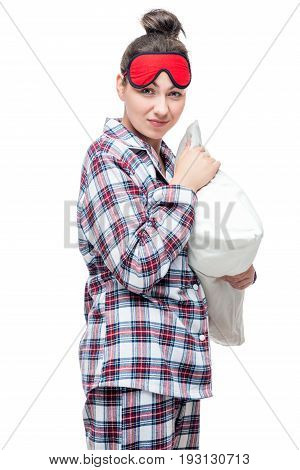 Vertical Portrait Of A Brunette With A Pillow In Hands Before Bedtime