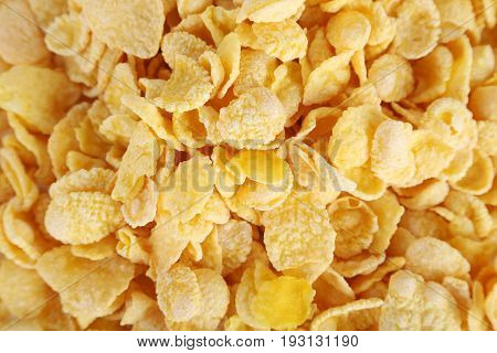 Pile of tasty cornflakes background, close up