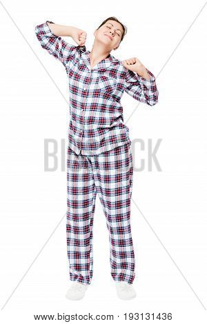 Young Girl In The Morning Stretches After Sleeping In Pajamas On A White Background