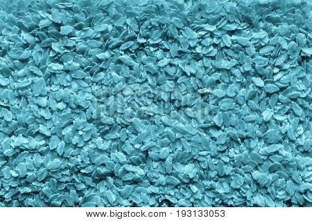 the textured background from granular flakes of an abstract form of dark blue color of a tifana