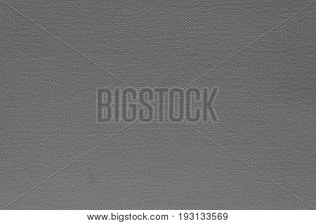 abstract grained texture of speckled fabric or paper material of dark gray color