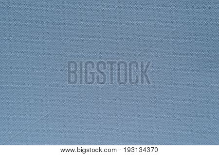 abstract grained texture of speckled fabric or paper material of blue color