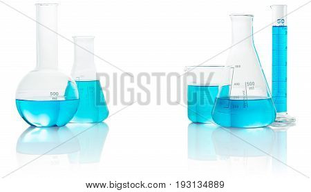 chemical glassware with blue liquid isolated on white