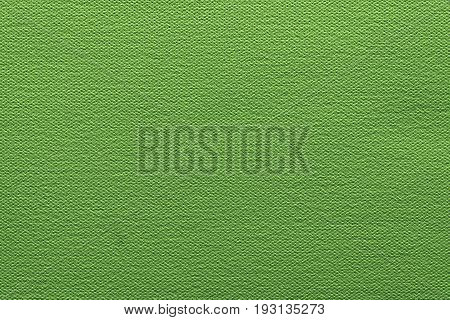 abstract grained texture of speckled fabric or paper material of bright green color