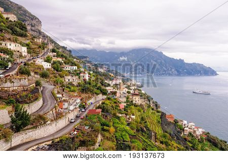 Hairpin bends of narrow zigzagging streets that climb up the steep slopes - Amalfi Campania Italy