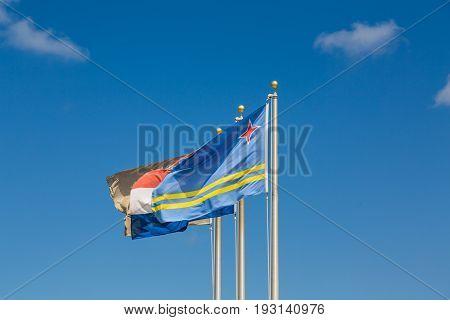 A Flag of Curacao on Blue Sky