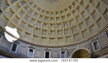 Rome, Italy / May 26th 2017. The landmark Pantheon in Rome Italy. Originally a temple and now a church it has a coffered concrete dome which has a central opening or oculus to the sky.