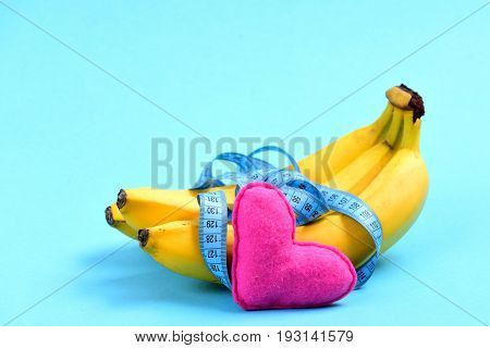 Bunch Of Bananas And Measuring Tape Near Pink Heart