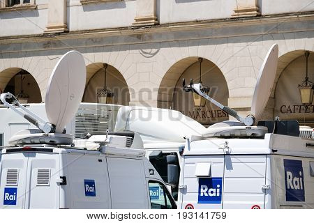 Milan, Italy - June, 19, 2017: vans with TV equipment near La Scala opera theatre in Milan, Italy