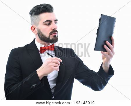 Businessman Or Manager With Serious Face Holds Pen And Organizer