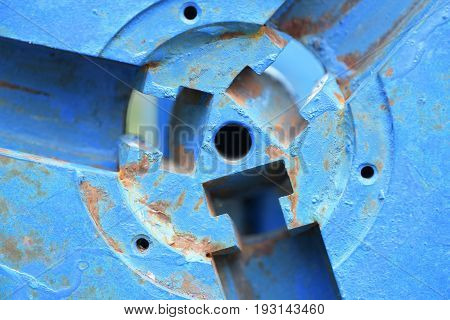 Part of sports equipment made of metal in blue color with rust close up. Can be used as background
