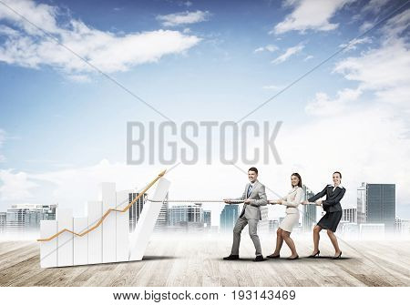 Young business people pulling up graph bar using rope