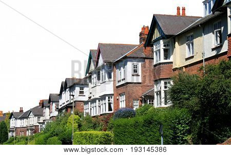 Row of modern houses in street, Scarborough, England isolated on white background.