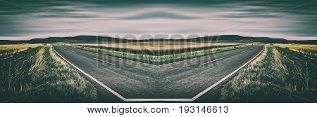 Surrealistic mirrored road in a rural landscape setting