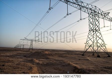 High Voltage Power Lines In Desert Valley