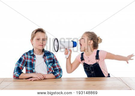 Angry Girl With Megaphone Yelling On Her Brother Isolated On White