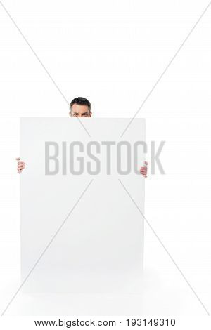 Obscured View Of Man Holding Blank Banner In Hands Isolated On White